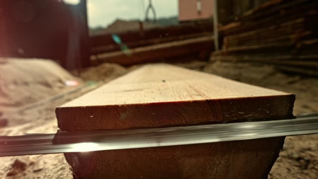 slo mo band saw cutting into lumber - timber yard stock videos & royalty-free footage