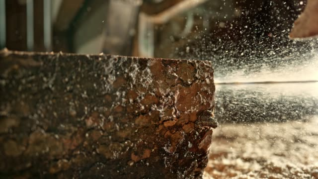 slo mo band saw of the sawmill cutting lumber into planks - lumberyard stock videos and b-roll footage