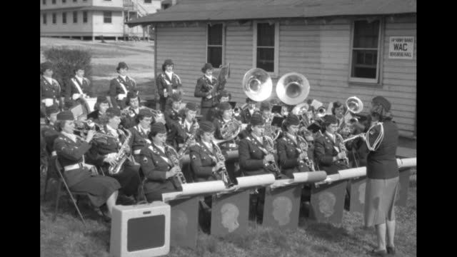 band sitting outdoors and waiting to play leader raises baton and band plays / band plays second tune / cu wac playing cymbals / two close views of... - womens army corps stock videos & royalty-free footage