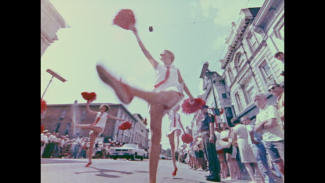 bands play and girls dance during the homecoming parade for apollo 11 - ホームカミング点の映像素材/bロール