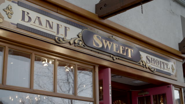 banff sweet shop sign / banff, canada - shop sign stock videos & royalty-free footage