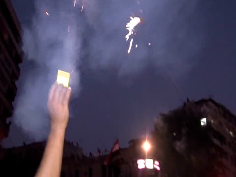 bangers and fireworks in tahrir square following mohammed mursi's election as president of egypt - president of egypt stock videos & royalty-free footage