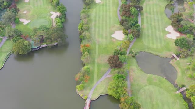 vídeos de stock, filmes e b-roll de bangkok aerial golf course - obstáculo de água