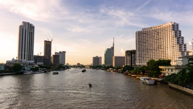 bangkok city at sunset with lighted at the downtown area with the chao phraya river - river chao phraya stock videos & royalty-free footage