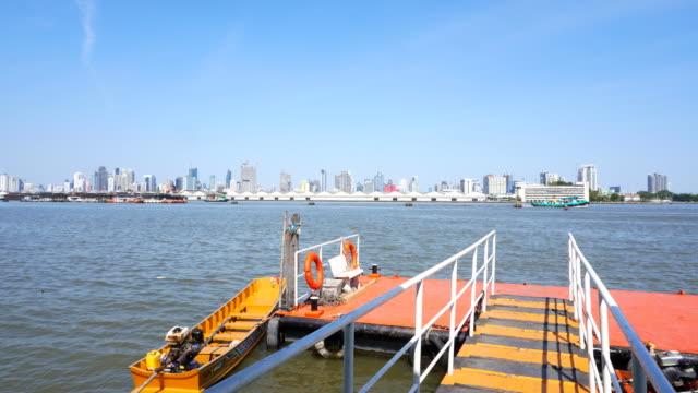 bangkok city at view jao praya river. panning - bangkok stock videos & royalty-free footage