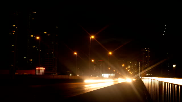 bangkok city traffic trails on bridge by twilight to night - elevated train stock videos & royalty-free footage