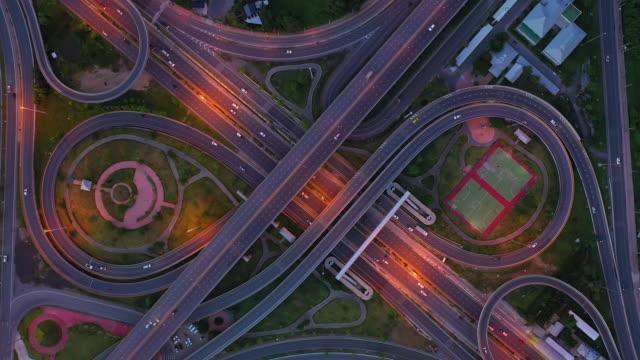 bangkok expressway top view, top view over the highway,expressway and motorway. aerial view interchange of a thailand bangkok city, shot from 4k hd drone. - sydostasien bildbanksvideor och videomaterial från bakom kulisserna