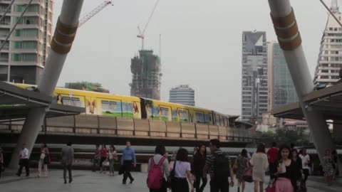 bangkok mass transit system pcl skytrain, a unit of bts group holdings pcl, travels on an elevated track above the chong nonsi intersection as... - elevated train stock videos & royalty-free footage