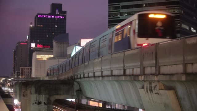A Bangkok Mass Transit System Pcl SkyTrain a unit of BTS Group Holdings Pcl travels along an elevated track out of Siam Station at night in central...
