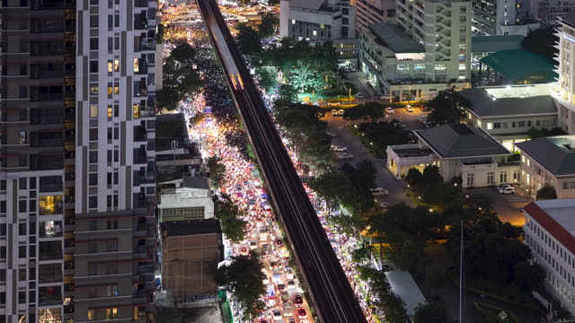 bangkok protest, aerial view of crowd moving from victory monument toward the parliament house of thailand - elevated train stock videos & royalty-free footage