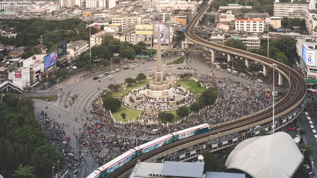bangkok protest, crowd gathering at victory monument - aerial stock videos & royalty-free footage