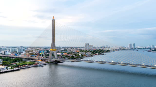 bangkok rama viii bridge crosses the chao phraya river - numero 8 video stock e b–roll
