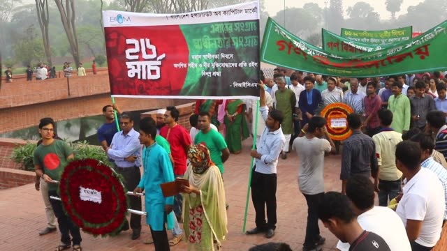 people gather at the national monument in the suburban savar district of dhaka bangladesh on march 26 to pay homage on its national day to the... - savar stock videos and b-roll footage