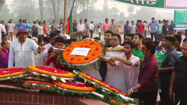 people gather at the national monument in the suburban savar district of dhaka, bangladesh, on march 26 to pay homage on its national day to the... - independence stock videos & royalty-free footage