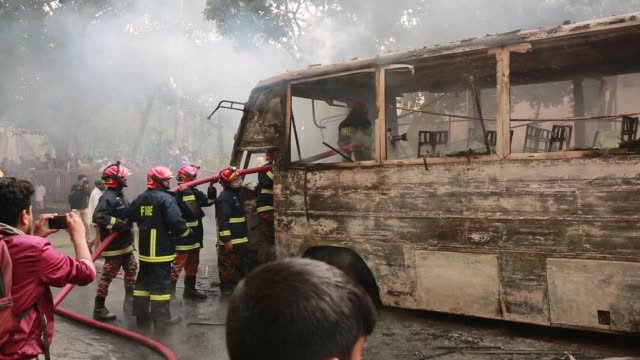 bangladesh fire service rescuing a fired bus using water which fired by gas cylinder bluest on a street of bangladeshi capital of dhaka on december... - cylinder stock videos & royalty-free footage