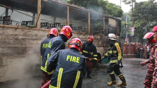 Bangladesh Fire Service rescuing a fired bus using water which fired by gas cylinder bluest on a street of Bangladeshi capital of Dhaka on December...