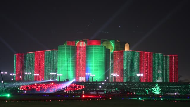 bangladesh parliament building is illuminated with lights in dhaka bangladesh dec 16 on the eve of the 49th victory day bangladesh on monday... - parliament building stock videos & royalty-free footage