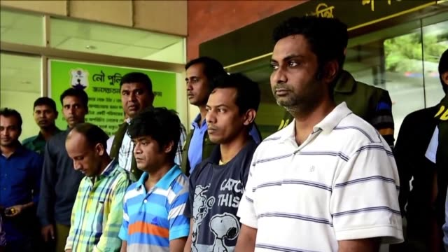 Bangladesh police parade four people detained over last months killing of a 50 year old Italian aid worker which authorities insist was a plot by the...