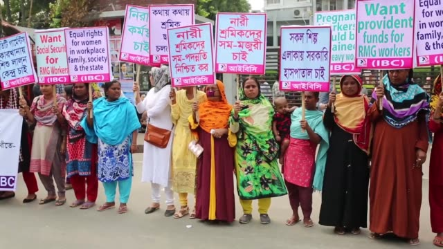Bangladeshi activists and garment workers attend a rally in front of National Press Club during International Women's Day in Dhaka Bangladesh on...