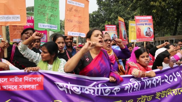 bangladeshi activists and garment workers attend a rally in front of national press club during international women's day in dhaka bangladesh on... - internationaler frauentag stock-videos und b-roll-filmmaterial