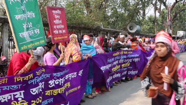 Bangladeshi activists and garment workers attend a rally outside National Press Club during International Women's Day in Dhaka Bangladesh Several...