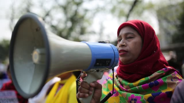 bangladeshi activists and garment workers attend a rally outside national press club during international women's day in dhaka, bangladesh. several... - raw footage stock videos & royalty-free footage
