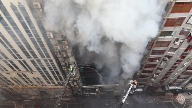 bangladeshi firefighters try to extinguish a blaze in an office building in dhaka on march 28, 2019. - a huge fire tore through a dhaka office block... - office block exterior stock-videos und b-roll-filmmaterial