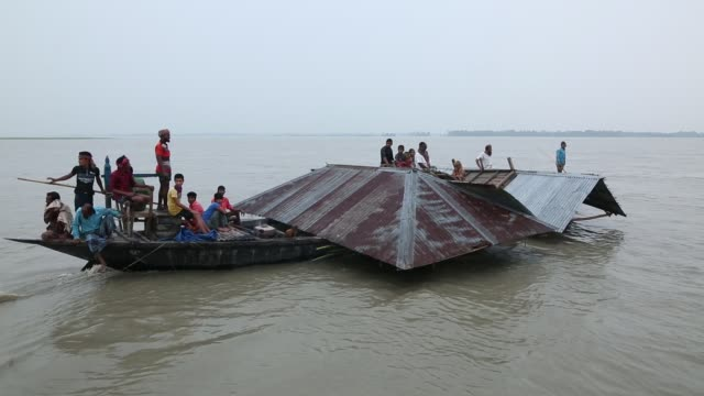 bangladeshi flood victim man carrying their submerged house by boat during flood in the northern part of bangladesh heavy monsoon rains have... - bangladesh stock videos & royalty-free footage