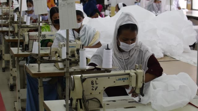 bangladeshi garment workers make protective suit at a factory amid concerns over the spread of the coronavirus disease in dhaka bangladesh april 1... - medium group of people stock videos & royalty-free footage