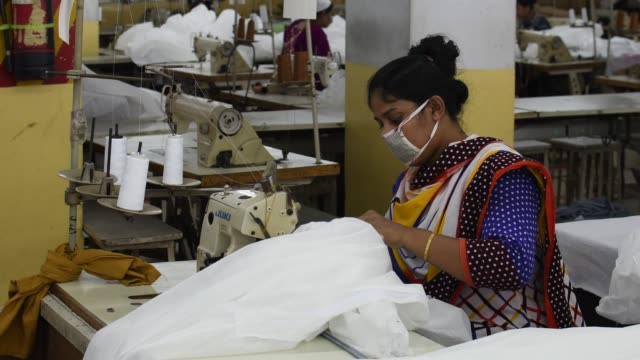 bangladeshi garment workers make protective suit at a factory amid concerns over the spread of the coronavirus disease in dhaka, bangladesh, april 1,... - garment stock videos & royalty-free footage