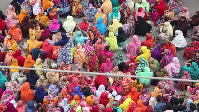 Bangladeshi garments workers gather on the streets of Dhaka demonstration to demand wage hikes Bangladesh's 4500 textile and clothing factories...