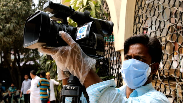 bangladeshi journalist with face mask works amid coronavirus outbreak in dhaka, bangladesh on march 20, 2020. bangladesh has confirmed 20 cases, with... - journalist stock videos & royalty-free footage