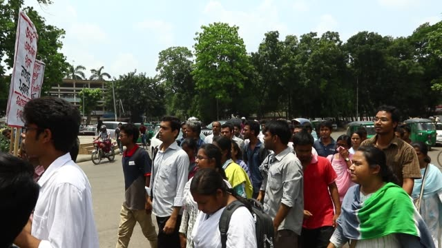 Bangladeshi left wing students march in the street towards the Supreme Court to protest in Dhaka on May 26 2017 after the removal of a controversial...