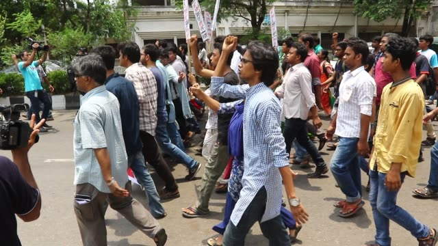bangladeshi left wing students march in the street towards the supreme court to protest in dhaka on may 26, 2017 after the removal of a controversial... - water cannon stock videos & royalty-free footage