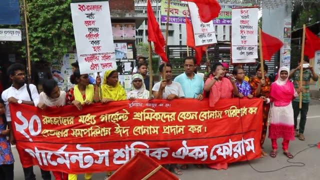 bangladeshi members of the bangladesh garment sromik adhikar andolon take part in a rally in dhaka on 17 june 2016 bangladeshi garment workers... - chain stock videos and b-roll footage