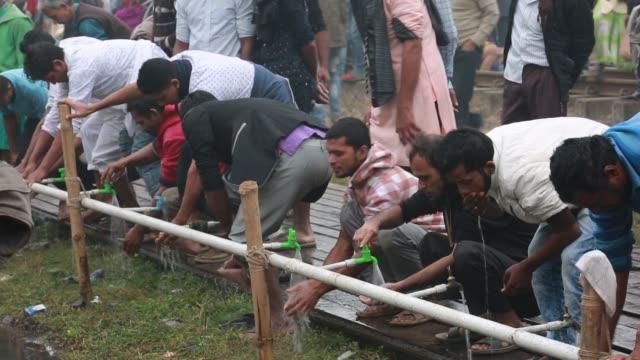 Bangladeshi Muslim devotees perform ablution to take part in Akheri Munajat the final prayers at the World Muslim Congregation Biswa Ijtema at Tongi...