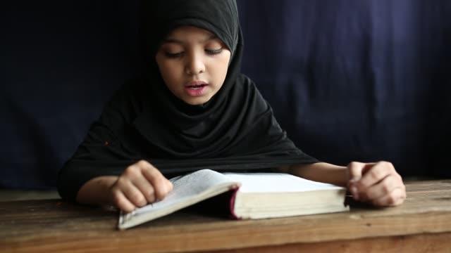 bangladeshi muslim students of a madrasa recite the holy koran during the month of ramadan in dhaka bangladesh on may 19 2018 muslims around the... - koran stock videos & royalty-free footage