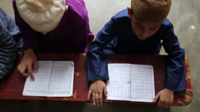 bangladeshi muslim students of a madrasa recite the holy koran during the month of ramadan in dhaka bangladesh on may 19 2018 muslims around the... - madressa stock videos and b-roll footage