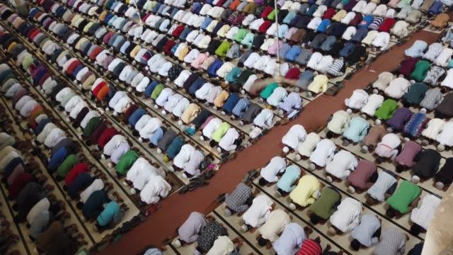bangladeshi muslims perform the first friday prayer at first day of ramadan during the muslim holy fasting month of ramadan in dhaka , bangladesh. - islam stock videos & royalty-free footage