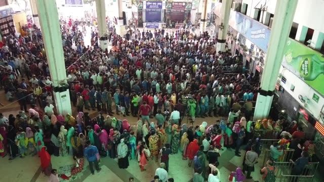 bangladeshi muslims queue up to buy train tickets to reach their homes to celebrate eid aladha at the kamalapur railway station in dhaka bangladesh... - bangladeshi culture stock videos & royalty-free footage