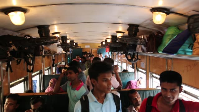 bangladeshi people board an overcrowded train travelling to to their home towns at, airport station in dhaka, bangladesh on june 22, 2017. thousands... - bahnreisender stock-videos und b-roll-filmmaterial