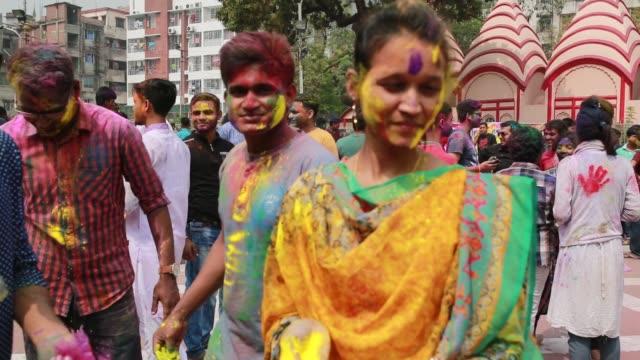 stockvideo's en b-roll-footage met bangladeshi people celebrate holi festival in dhaka bangladesh on march 01 2018 the holi festival is celebrated to mark the onset of spring with... - holi phagwa