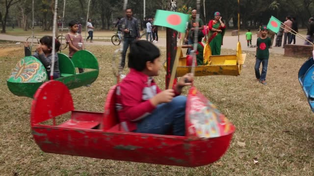 stockvideo's en b-roll-footage met bangladeshi people celebrate the country's victory day in dhaka bangladesh bangladesh marks its 45th victory day to commemorate the victory of the... - nationale vlag
