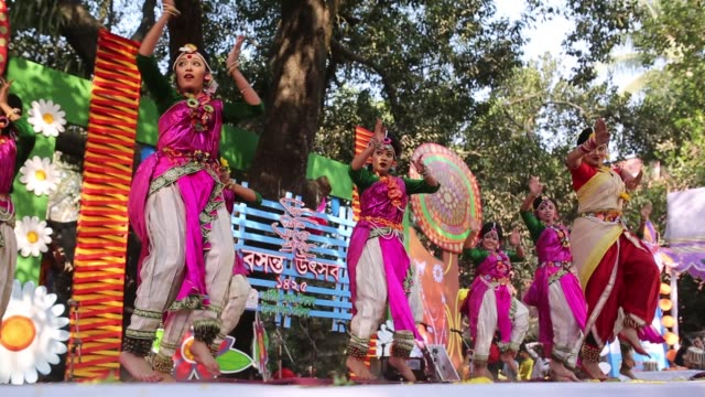 bangladeshi people celebrate the pahela falgun at the dhaka university campus in dhaka bangladesh hundreds of people joined in the cultural festival... - bangladeshi culture stock videos & royalty-free footage