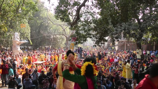 bangladeshi people celebrate the pahela falgun at the dhaka university campus in dhaka bangladesh hundreds of people joined in the cultural festival... - 付着点の映像素材/bロール