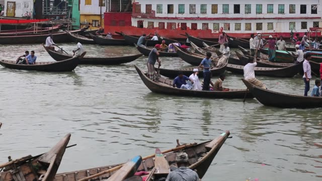 Bangladeshi people crossing the Buriganga river by boat during heavy rainfall in Dhaka Bangladesh on August 03 2017 / Venturing outdoors may become...