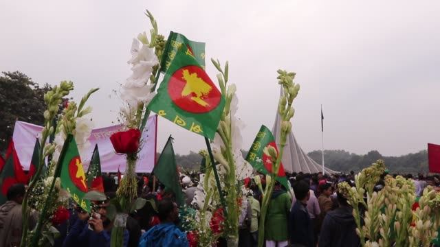 bangladeshi people gather with flags and flowers to show their respect during the celebration of the country's victory day at the memorial of the... - savar stock videos and b-roll footage