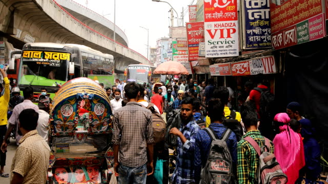 bangladeshi people gathered bus terminal as they leave capital city amid spread of the covid-19 coronavirus outbreak in dhaka, bangladesh on march... - contracting stock videos & royalty-free footage