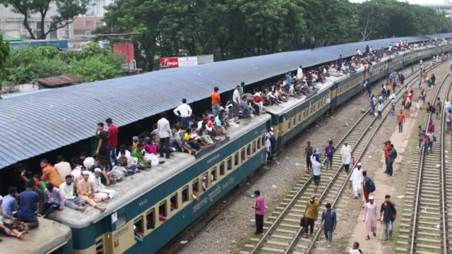 bangladeshi people ride on an overcrowded train rush home to celebrate eiduladha festival with their families and friends in dhaka bangladesh on... - roof stock videos & royalty-free footage