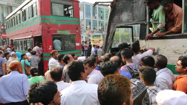 bangladeshi people try to ride in of an overcrowded bus to travel home as others wait for transport ahead of iftar in dhaka bangladesh on june 20... - fasting activity stock videos & royalty-free footage